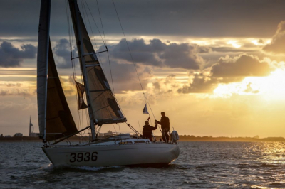 As the sun rises over the Solent, the two handed team on Charles Emmett and Tim Winsey's Sigma 36 British Beagle make their way to the finish line in Cowes to secure a win in IRC 4 © Paul Wyeth