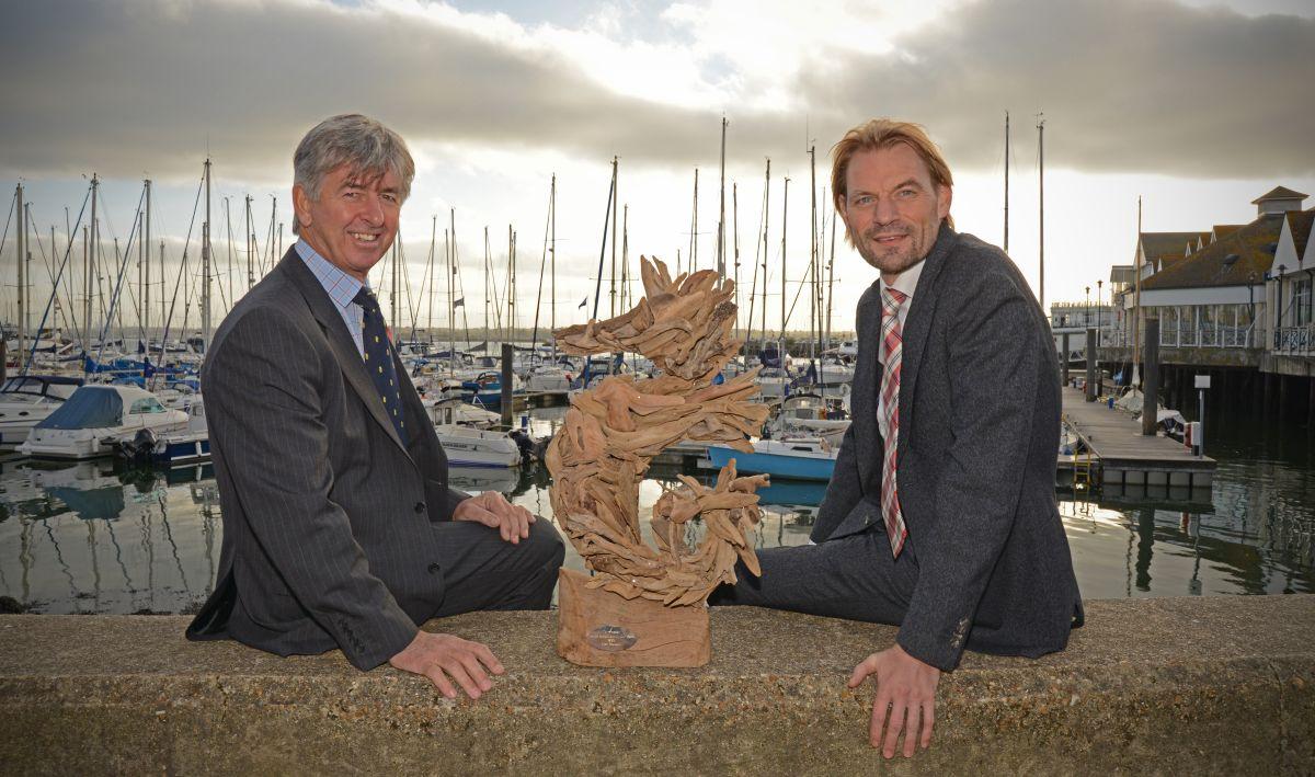 Eddie Warden Owen (RORC CEO) and Richard Klabbers (Sevenstar Managing Director) with the Sevenstar Round Britain and Ireland Race Trophy. Photo: Owen Buggy