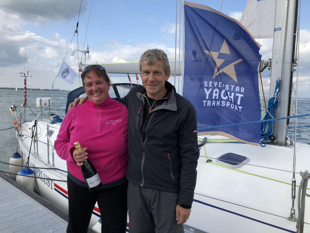 Charlene Howard and Neal Brewer after completing the RORC's Sevenstar Round Britain and Ireland Race
