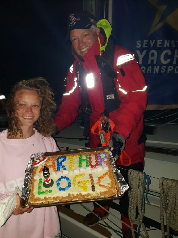 A huge welcome and cake for the team on Arthur Logic after completing the 1,805 nm Sevenstar Round Britain and Ireland Race © Arthur Logic