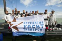 Jens Kellinghusen and his crew of Varuna celebrating at the finish of the Sevenstar Round Britain and Ireland Race - photo RORC/Patrick Eden